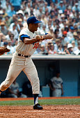 Maury Wills of the Los Angeles Dodgers bunts at the ball during an Major League Baseball game circa 1963 at Dodgers Stadium in Los Angeles California...