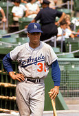 Maury Wills of the Los Angeles Dodgers looks on from the ondeck circle during an Major League Baseball game circa 1963 Wills played for the Dodgers...