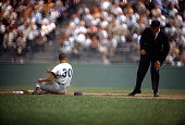 Maury Wills of the Los Angeles Dodgers slides into second base during an Major League Baseball game circa 1963 at Dodgers Stadium in Los Angeles...