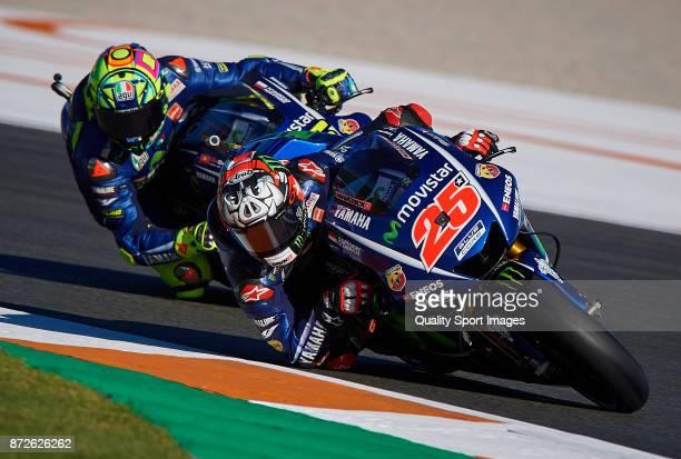 Maverick Vinales of Spain and Movistar Yamaha MotoGP and Valentino Rossi of Italy and Movistar Yamaha MotoGP rides during the MotoGP of Valencia...