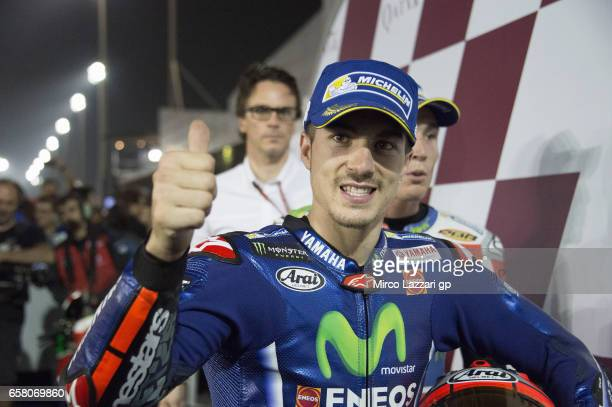 Maverick Vinales of Spain and Movistar Yamaha MotoGP celebrates the victory under the podium at the end of the MotoGP race during the MotoGp of Qatar...