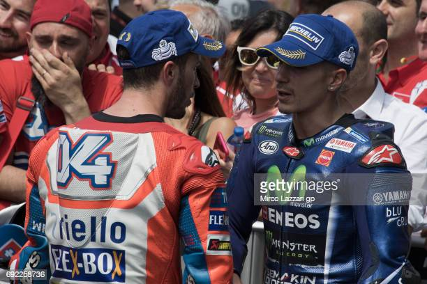 Maverick Vinales of Spain and Movistar Yamaha MotoGP celebrates with Andrea Dovizioso of Italy and Ducati Team at the end of the MotoGP race during...