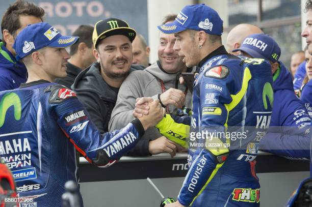 Maverick Vinales of Spain and Movistar Yamaha MotoGP congratulates with Valentino Rossi of Italy and Movistar Yamaha MotoGP at the end of the...