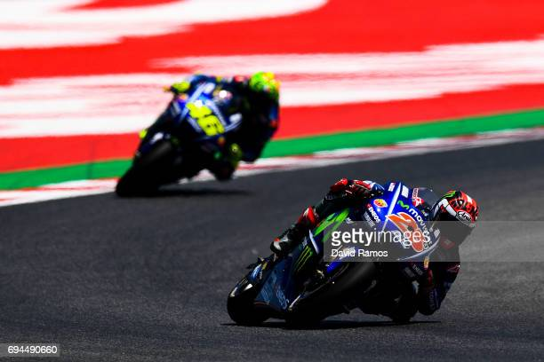 Maverick Vinales of Spain and Movistar Yamaha MotoGP rides ahead his team mate Valentino Rossi of Italy during a free practice session ahead of the...