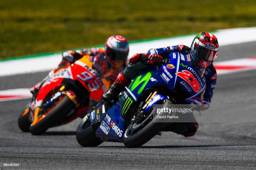 Maverick Vinales of Spain and Movistar Yamaha MotoGP rides ahead Marc Marquez of Spain and Repsol Honda Team during the qualifying at Circuit de Catalunya on June 10, 2017 in Montmelo, Spain.
