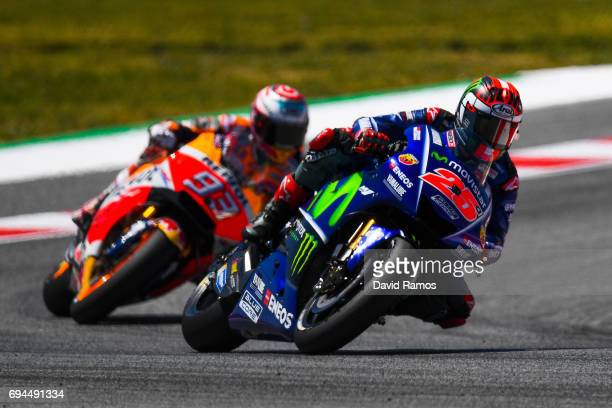 Maverick Vinales of Spain and Movistar Yamaha MotoGP rides ahead Marc Marquez of Spain and Repsol Honda Team during the qualifying at Circuit de...