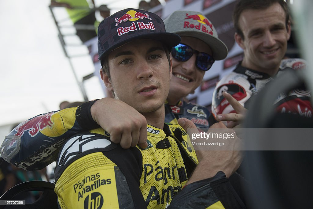 <a gi-track='captionPersonalityLinkClicked' href=/galleries/search?phrase=Maverick+Vinales&family=editorial&specificpeople=7535430 ng-click='$event.stopPropagation()'>Maverick Vinales</a> of Spain and Pons HP40, <a gi-track='captionPersonalityLinkClicked' href=/galleries/search?phrase=Jack+Miller+-+Motorcycle+Racer&family=editorial&specificpeople=14824906 ng-click='$event.stopPropagation()'>Jack Miller</a> of Australia and Red Bull KTM Ajo and <a gi-track='captionPersonalityLinkClicked' href=/galleries/search?phrase=Johann+Zarco&family=editorial&specificpeople=4501201 ng-click='$event.stopPropagation()'>Johann Zarco</a> of French and Caterham Moto Racing smile during the pre-event 'MotoGP riders the Mini Bikes race' during the MotoGP Of Malaysia - Preview at Sepang Circuit on October 23, 2014 in Kuala Lumpur, Malaysia.