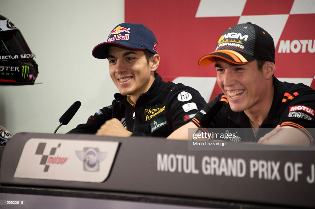 <a gi-track='captionPersonalityLinkClicked' href=/galleries/search?phrase=Maverick+Vinales&family=editorial&specificpeople=7535430 ng-click='$event.stopPropagation()'>Maverick Vinales</a> (L) of Spain and Pons HP40 smiles during the press conference pre-event during the MotoGP Of Japan - Previews at Twin Ring Motegi on October 9, 2014 in Motegi, Japan.