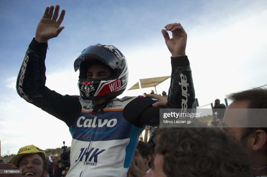 <a gi-track='captionPersonalityLinkClicked' href=/galleries/search?phrase=Maverick+Vinales&family=editorial&specificpeople=7535430 ng-click='$event.stopPropagation()'>Maverick Vinales</a> of Spain and Team Calvo (Moto3 World Champion) celebrates the Moto3 victory and the Moto3 title after the Moto3 race during the MotoGP of Valencia - Race at Ricardo Tormo Circuit on November 10, 2013 in Valencia, Spain.