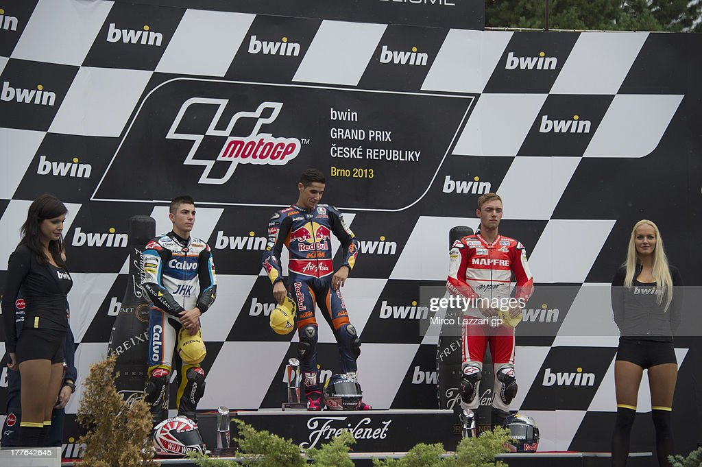 Maverick Vinales of Spain and Team Calvo, Luis Salom of Spain and Red Bull KTM Ajo and Jonas Folger of Germany and Kalex KTM Team Aspar poses on the podium at the end of the Moto3 race during the MotoGp of Czech Republic - Race at Brno Circuit on August 25, 2013 in Brno, Czech Republic.