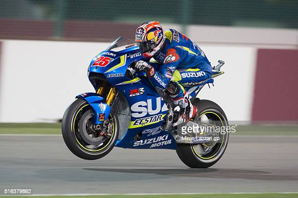 Maverick Vinales of Spain and Team Suzuki ECSTAR lifts the front wheel during the MotoGp of Qatar Free Practice at Losail Circuit on March 18 2016 in...