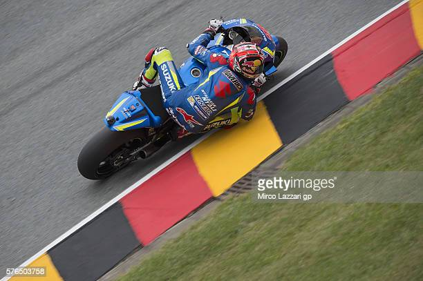 Maverick Vinales of Spain and Team Suzuki ECSTAR rounds the bend during the MotoGp of Germany Free Practice at Sachsenring Circuit on July 15 2016 in...