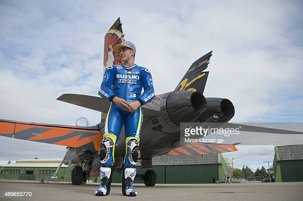 Maverick Vinales of Spain and Team Suzuki MotoGP poses near the fighter plane and emulates his namesake from 'Top Gun' during the PreEvent at the...