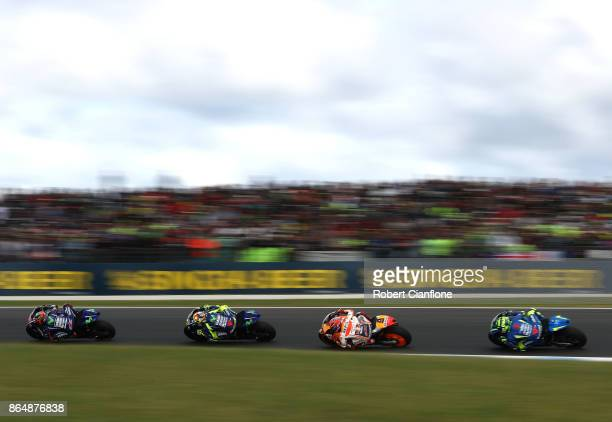 Maverick Vinales of Spain riding the MOVISTAR YAMAHA MotoGP is chased by Valentino Rossi of Italy riding the MOVISTAR YAMAHA MotoGP Yamaha Marc...