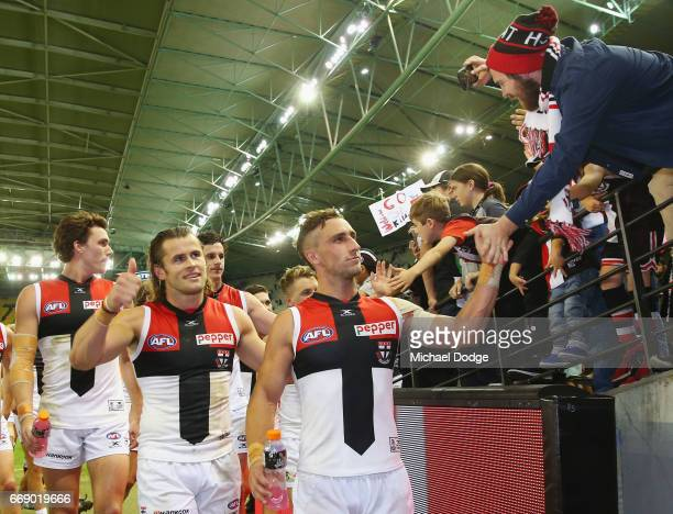 Maverick Weller and Luke Dunstan of the Saints celebrate the win with fans during the round four AFL match between the Collingwood Magpies and the St...
