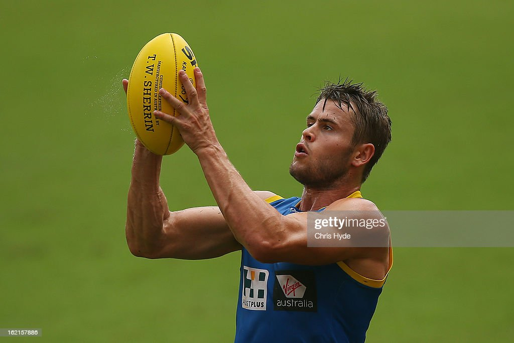 Maverick Weller marks the ball during a Gold Coast Suns AFL training session at Metricon Stadium on February 20, 2013 in Gold Coast, Australia.