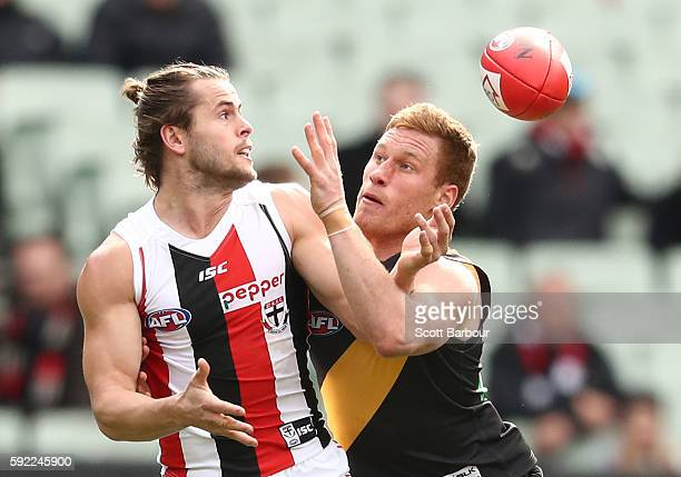 Maverick Weller of the Saints and Nick Vlastuin of the Tigers compete for the ball during the round 22 AFL match between the Richmond Tigers and the...