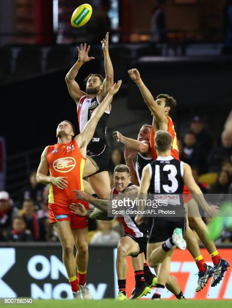 Maverick Weller of the Saints attempts to mark the ball during the round 14 AFL match between the St Kilda Saints and the Gold Coast Suns at Etihad...