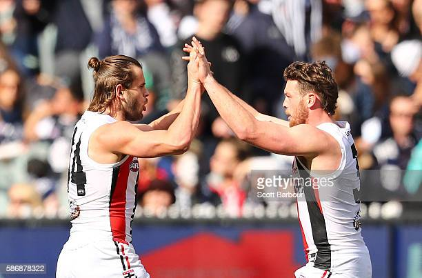 Maverick Weller of the Saints celebrates after kicking a goal with Jack Steven of the Saints during the round 20 AFL match between the Carlton Blues...