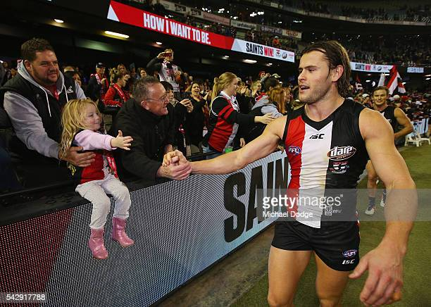 Maverick Weller of the Saints celebrates the win with fans during the round 14 AFL match between the St Kilda Saints and the Geelong Cats at Etihad...
