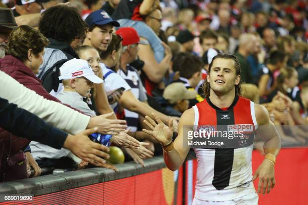 Maverick Weller of the Saints celebrates the win with fans during the round four AFL match between the Collingwood Magpies and the St Kilda Saints at...