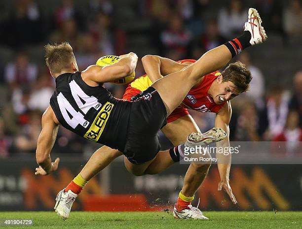 Maverick Weller of the Saints collides with David Swallow of the Suns during the round nine AFL match between the St Kilda Saints and the Gold Coast...