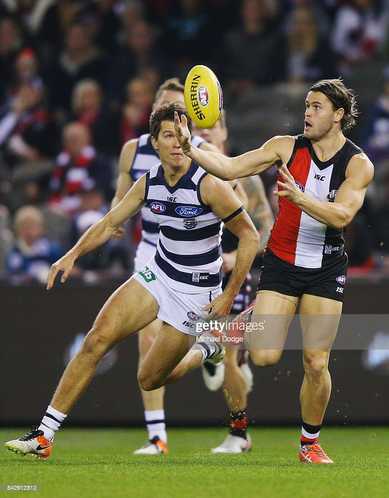 Maverick Weller of the Saints gathers the ball from Andrew Mackie of the Cats during the round 14 AFL match between the St Kilda Saints and the Geelong Cats at Etihad Stadium on June 25, 2016 in Melbourne, Australia.