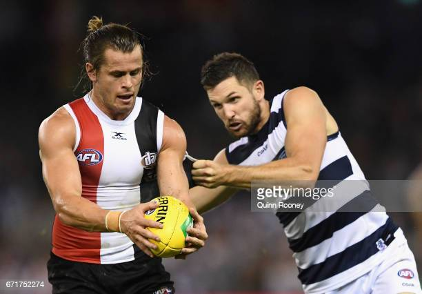 Maverick Weller of the Saints is tackled by Aaron Black of the Cats during the round five AFL match between the St Kilda Saints and the Geelong Cats...