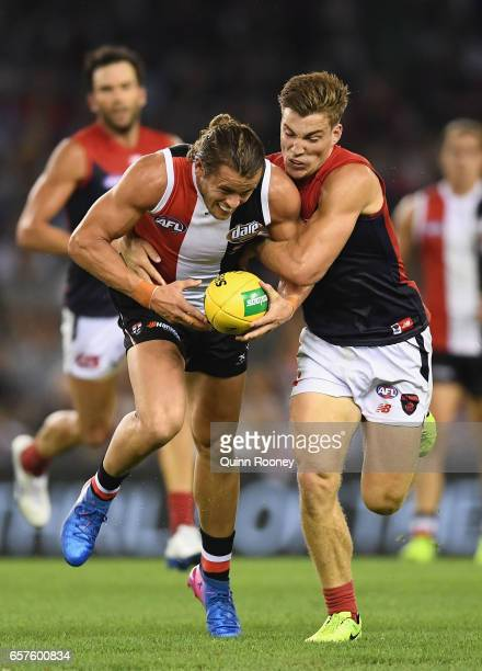 Maverick Weller of the Saints is tackled by Jack Viney of the Demons during the round one AFL match between the St Kilda Saints and the Melbourne...