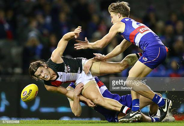 Maverick Weller of the Saints is tackled by Josh Dunkley of the Bulldogs during the round 18 AFL match between the Western Bulldogs and the St Kilda...