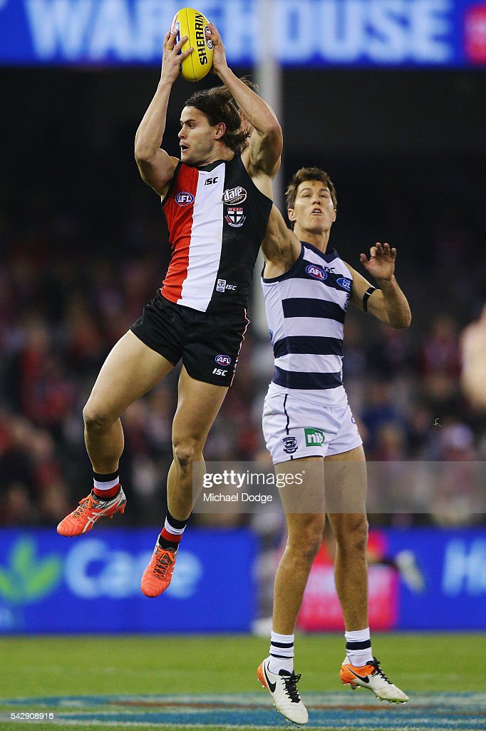 Maverick Weller of the Saints marks the ball against Andrew Mackie of the Cats during the round 14 AFL match between the St Kilda Saints and the Geelong Cats at Etihad Stadium on June 25, 2016 in Melbourne, Australia.