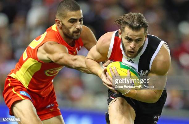 Maverick Weller of the Saints marks the ball during the round 14 AFL match between the St Kilda Saints and the Gold Coast Suns at Etihad Stadium on...