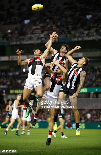 Maverick Weller of the Saints Tyson Goldsack of the Magpies Josh Bruce of the Saints and Jesse White of the Magpies compete for the ball during the...