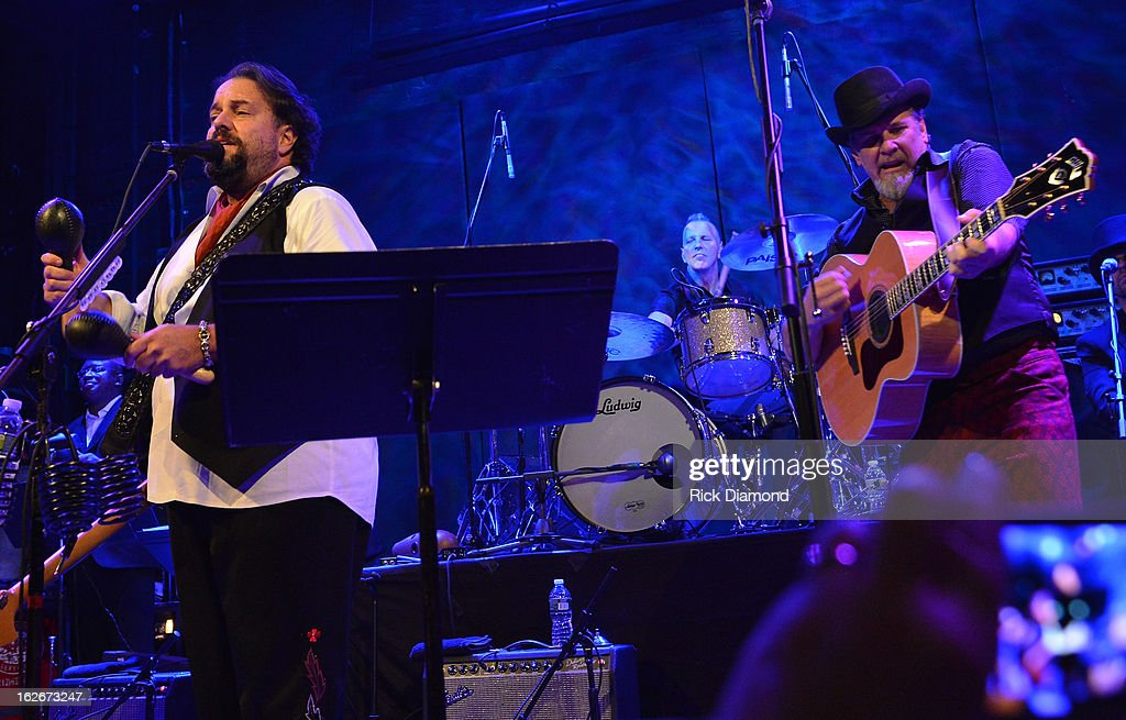 Mavericks members <a gi-track='captionPersonalityLinkClicked' href=/galleries/search?phrase=Raul+Malo&family=editorial&specificpeople=2159740 ng-click='$event.stopPropagation()'>Raul Malo</a>, Jerry Dale McFadden and Robert Reynolds perform during The Mavericks Album release concert for there new album ' In Time' at The Bowery Ballroom on February 25, 2013 in New York City.