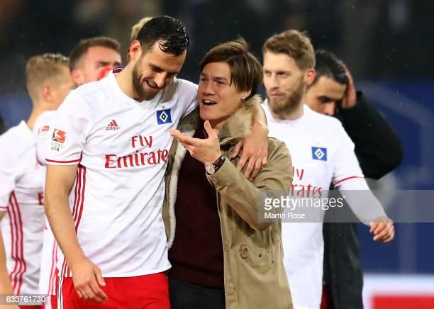 Mavraj Mergim of Hamburg talks to team mate Gotoku Sakai after the Bundesliga match between Hamburger SV and Bayer 04 Leverkusen at Volksparkstadion...