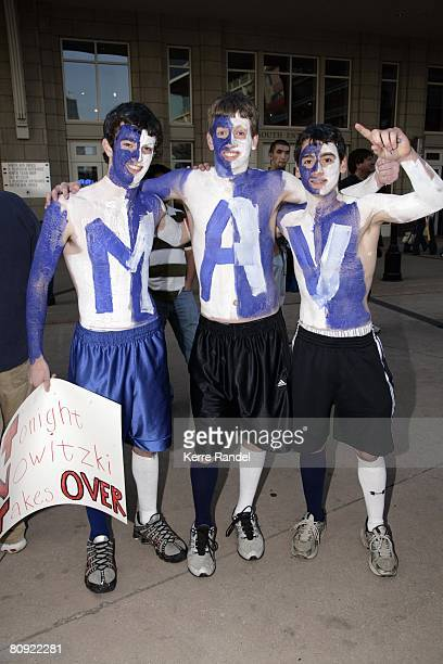 Mavs fans pose for a photo prior to Game Four of the Western Conference Quarterfinals between the New Orleans Hornets and the Dallas Mavericks during...