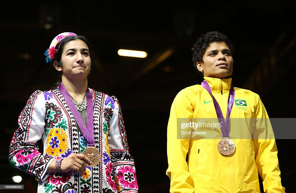 <a gi-track='captionPersonalityLinkClicked' href=/galleries/search?phrase=Mavzuna+Chorieva&family=editorial&specificpeople=9403602 ng-click='$event.stopPropagation()'>Mavzuna Chorieva</a> of Tajikistan and Bronze medalists <a gi-track='captionPersonalityLinkClicked' href=/galleries/search?phrase=Adriana+Araujo&family=editorial&specificpeople=6872072 ng-click='$event.stopPropagation()'>Adriana Araujo</a> of Brazil are seen during the medal ceremony for the Women's Light (60kg) Boxing final bout on Day 13 of the London 2012 Olympic Games at ExCeL on August 9, 2012 in London, England.