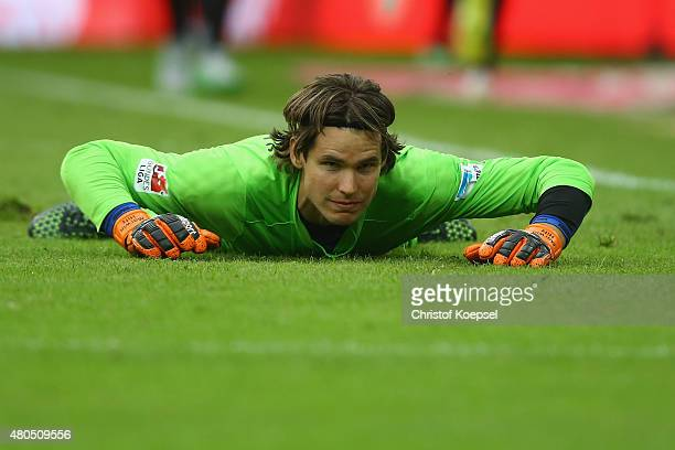 MAwrin Hitz of Augsburg lies dejected on the pitch losing the Telekom Cup 2015 final match between Hambruger SV and FC Augsburg at BorussiaPark on...
