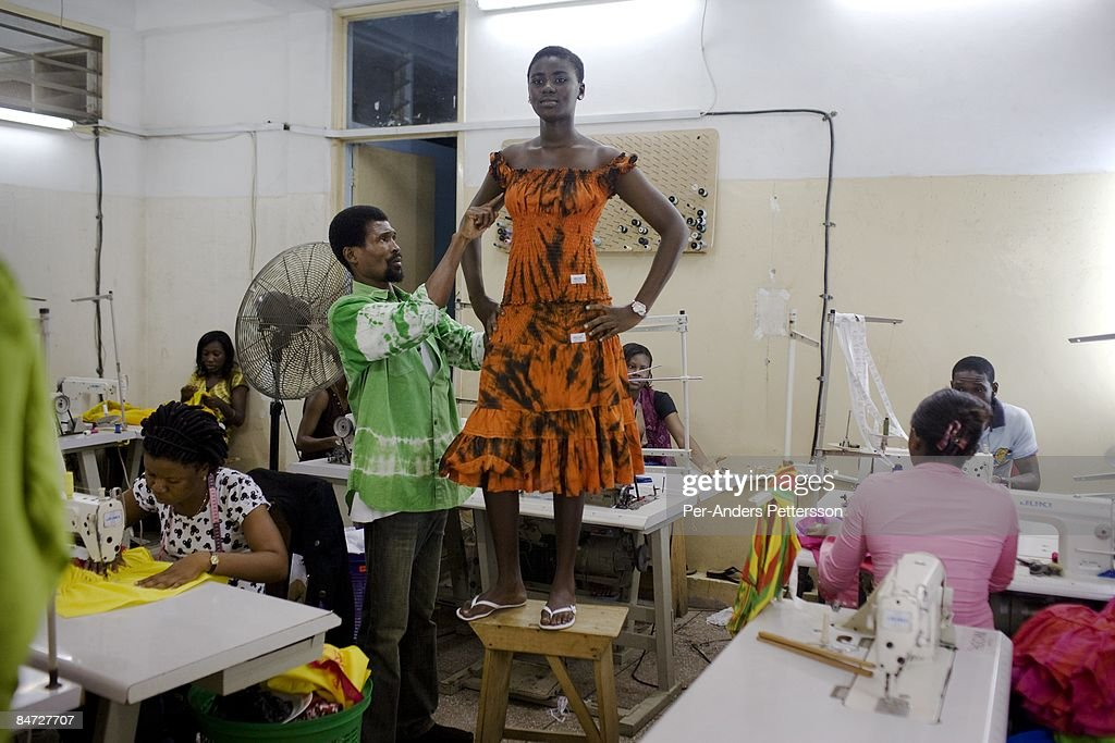 Mawuli Kofi Okudzeto, a fashion designer, fits a new dress on a model in the back of his factory on June 13, 2008 in central Accra, Ghana. His clothing line MKOGH is famous and he hopes to work with Herman Chinery-Hesse, a local software entrepreneur, who is pioneering to bringing e-commerce to remote corners of the continent.