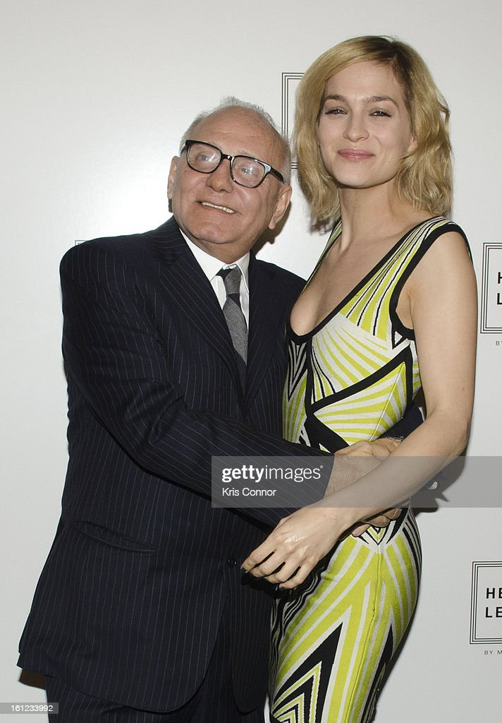 Max Azria and <a gi-track='captionPersonalityLinkClicked' href=/galleries/search?phrase=Leigh+Lezark&family=editorial&specificpeople=618872 ng-click='$event.stopPropagation()'>Leigh Lezark</a> pose for a photo during the Herve Leger By Max Azria Fall 2013 show during Mercedes-Benz Fashion Weekat The Theater at Lincoln Center on February 9, 2013 in New York City.