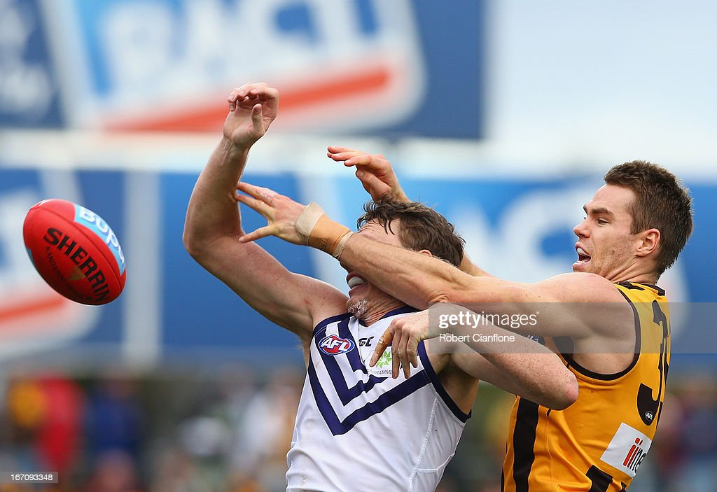 Max Bailey of the Hawks challenges Jonathon Griffin of the Dockers during the round four AFL match between the Hawthorn Hawks and the Fremantle Dockers at Aurora Stadium on April 20, 2013 in Launceston, Australia.