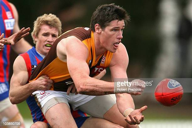 Max Bailey of the Hawks handballs under pressure during the First VFL Semi Final match between Port Melbourne and the Box Hill Hawks at Teac Oval on...