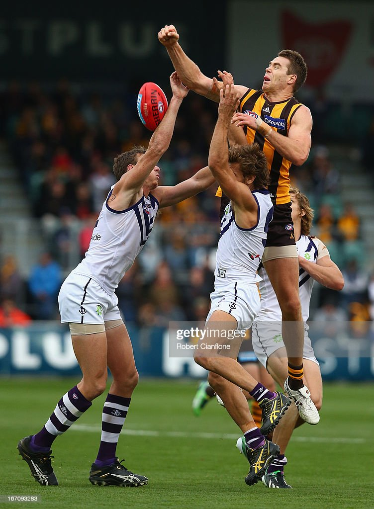 Max Bailey of the Hawks punches the ball during the round four AFL match between the Hawthorn Hawks and the Fremantle Dockers at Aurora Stadium on April 20, 2013 in Launceston, Australia.