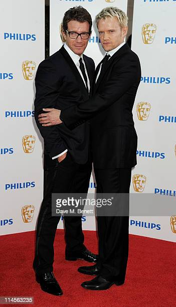 Max Beesley and Marc Warren arrive at the Philips British Academy Television Awards held at The Grosvenor House Hotel on May 22 2011 in London England