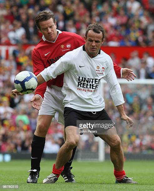 Max Beesley clashes with Austin Healy during the United Relief charity match in aid of Sport Relief and the Manchester United Foundation between...