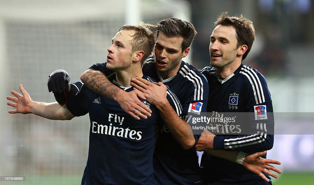 Max Beister (L) of Hamburg celebrate with his team mates after he scores his team's opening goal during the Bundesliga match between VfL Wolfsburg and Hamburger SV at Volkswagen Arena on December 2, 2012 in Wolfsburg, Germany.