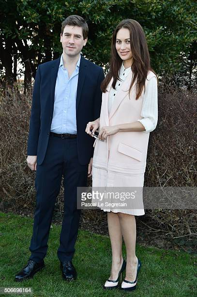 Max Benitz and Olga Kurylenko attend the Christian Dior Spring Summer 2016 show as part of Paris Fashion Week on January 25 2016 in Paris France