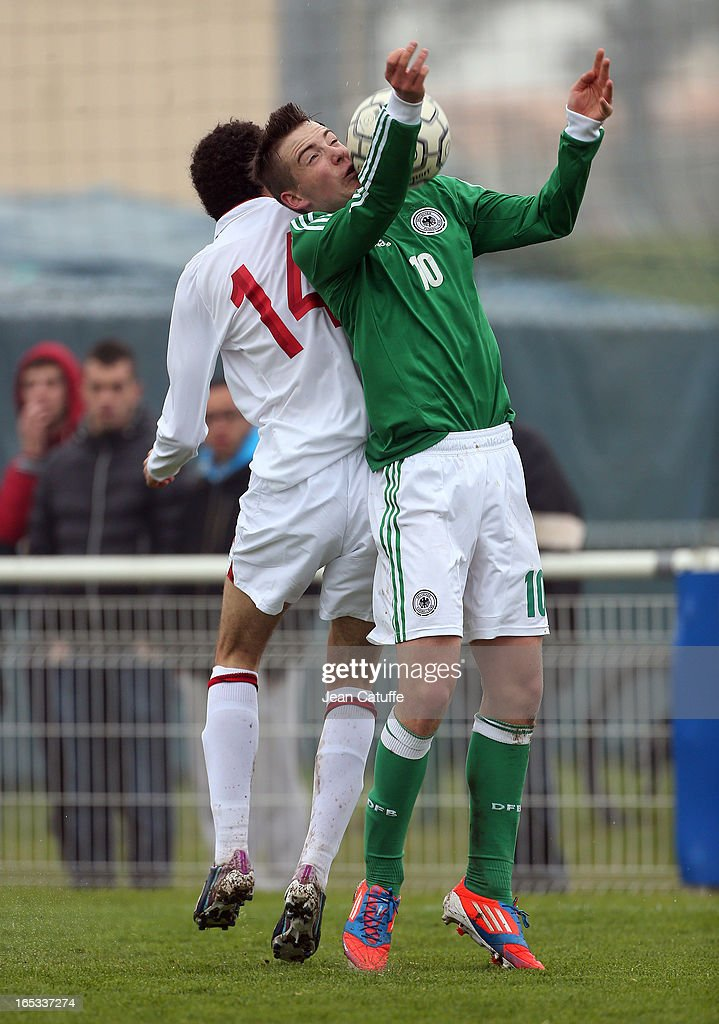 Max Besuschkow (R) of Germany and Isaac Christie-Davis of England in action during the Tournament of Montaigu qualifier match between U16 Germany and U16 England at the Stade Saint Andre D'Ornay on March 30, 2013 in La Roche-sur-Yon, France.