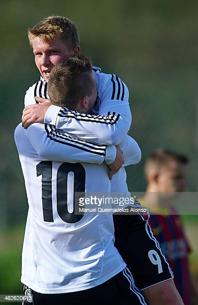 Max Besuschkow of Germany celebrates after scoring with his teammate Phillipp Ochs during the friendly match between U18 FC Barcelona and U17 Germany...