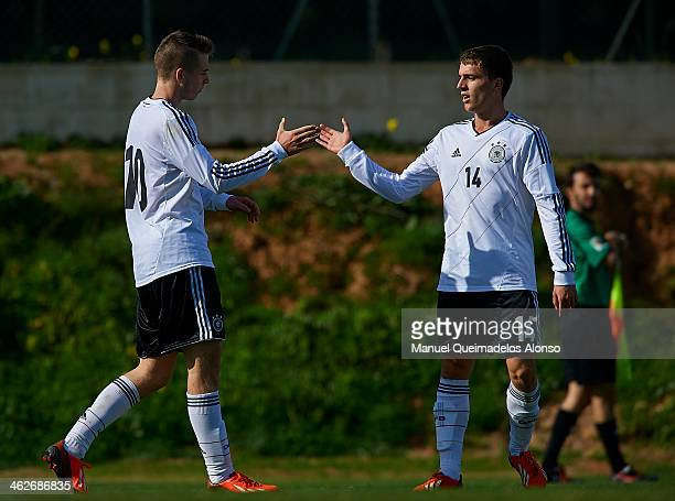 Max Besuschkow of Germany celebrates after scoring with his teammate Michael Strein during the friendly match between U18 FC Barcelona and U17...
